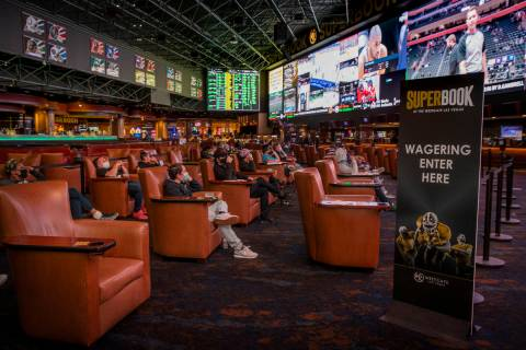 People sit and watch the events broadcasted as the Westgate sportsbook posts hundreds of Super ...