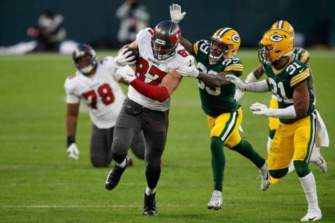 Green Bay Packers' Ka'dar Hollman (29) and Adrian Amos try to stop Tampa Bay Buccaneers' Rob Gr ...