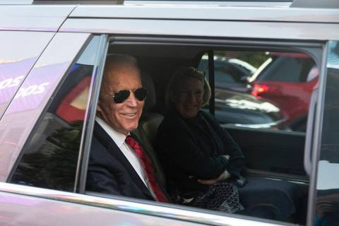 Democratic presidential candidate former Vice President Joe Biden, left, waits to pull into Par ...