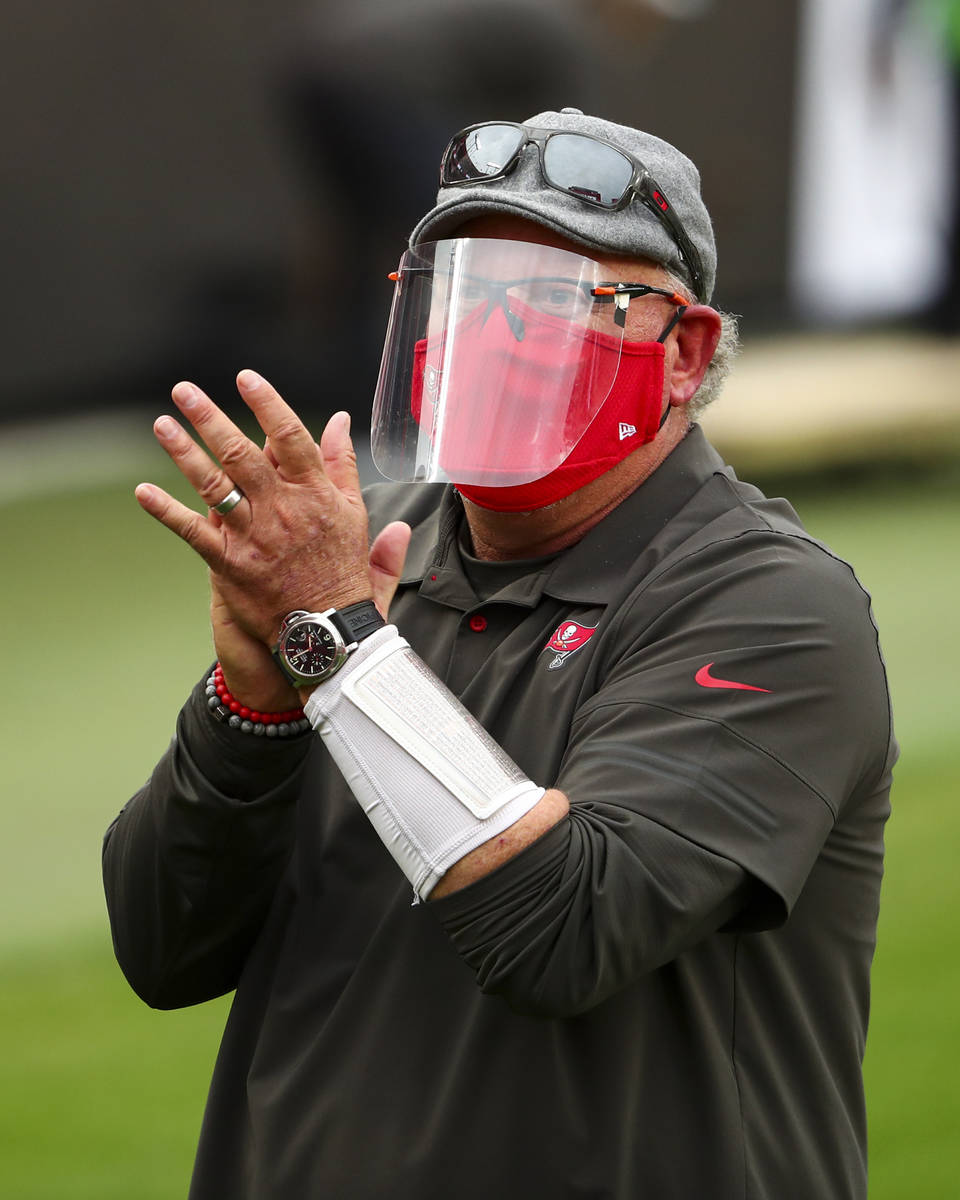 Tampa Bay Buccaneers head coach Bruce Arians walks to the locker room after beating the Atlanta ...