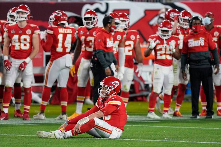 Kansas City Chiefs quarterback Patrick Mahomes (15) sits on the turf during the second half of ...