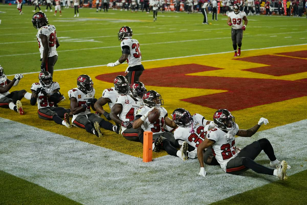 Tampa Bay Buccaneers strong safety Antoine Winfield Jr., holding the ball, celebrates after mak ...