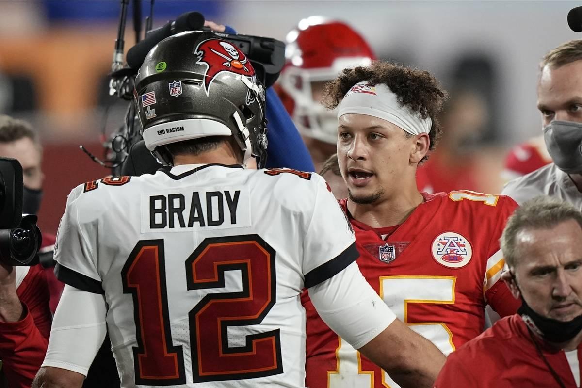 Tampa Bay Buccaneers quarterback Tom Brady, speaks with Kansas City Chiefs quarterback Patrick ...