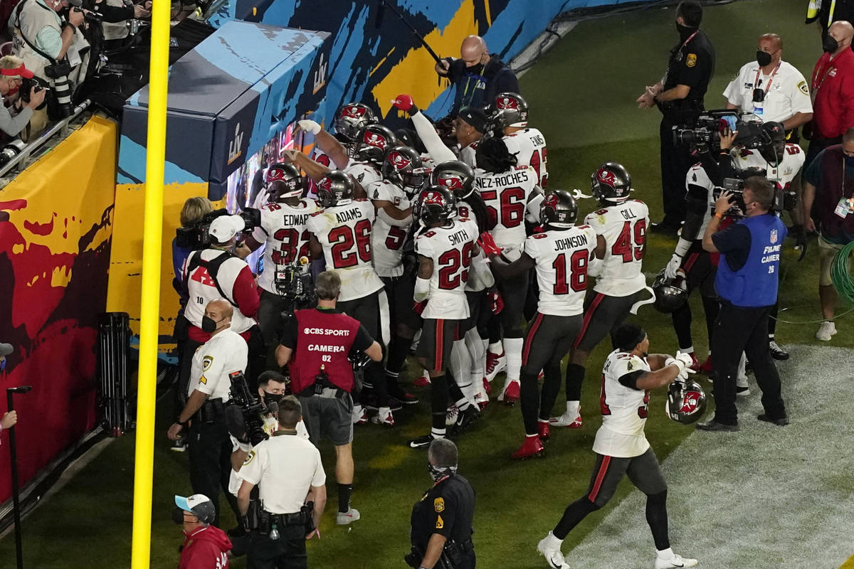 The Tampa Bay Buccaneers defense celebrates an interception during the second half of the NFL S ...