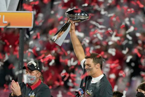 Tampa Bay Buccaneers quarterback Tom Brady celebrates with the Vince Lombardi Trophy after the ...