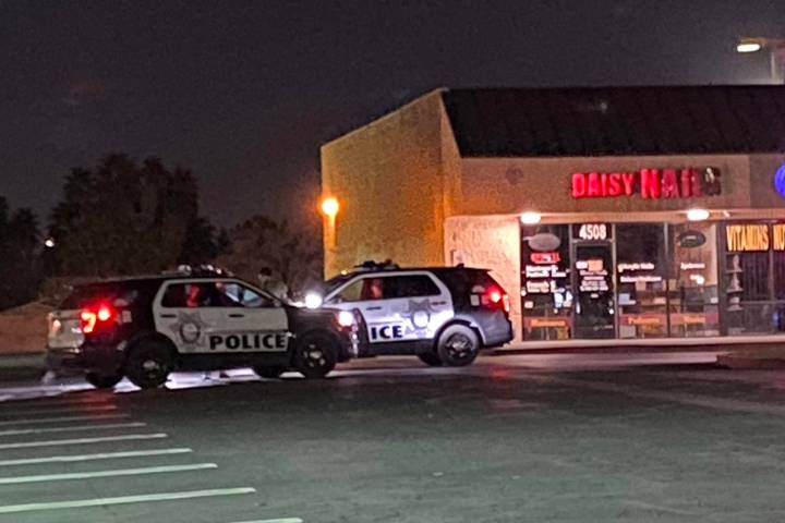 Las Vegas police at a strip mall at East Charleston and Lamb boulevards as they investigate abo ...
