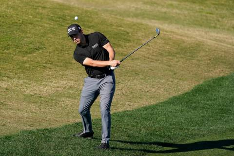Patrick Cantlay chips to the 16th hole during the final round of The American Express golf tour ...
