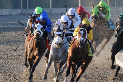Discreetly Mine, right, ridden by Javier Castellano, turns for home and goes on to win the Rise ...