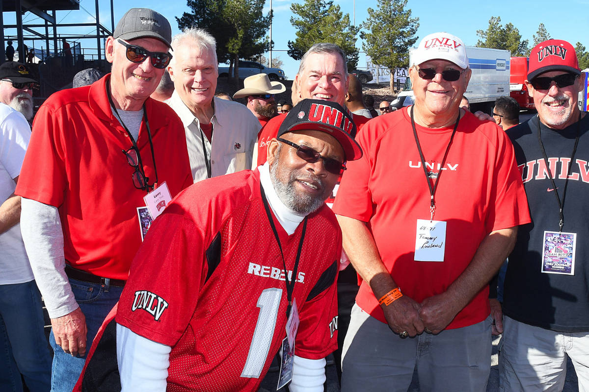 Former UNLV wide receiver Nate Hawkins poses for a photo with his teammates from the 1968 team. ...