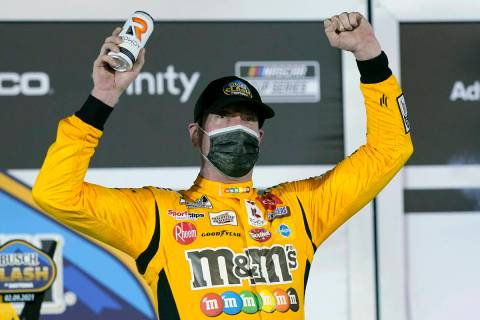 Kyle Busch celebrates in Victory Lane after winning the NASCAR Clash auto race at Daytona Inter ...