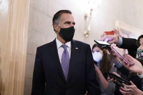Reporters vie for a response from Sen. Mitt Romney, R-Utah, as Senators take a dinner break whi ...