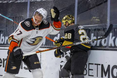 Anaheim Ducks defenseman Trevor Carrick (47) has his helmet rocked after a hard check from Gold ...
