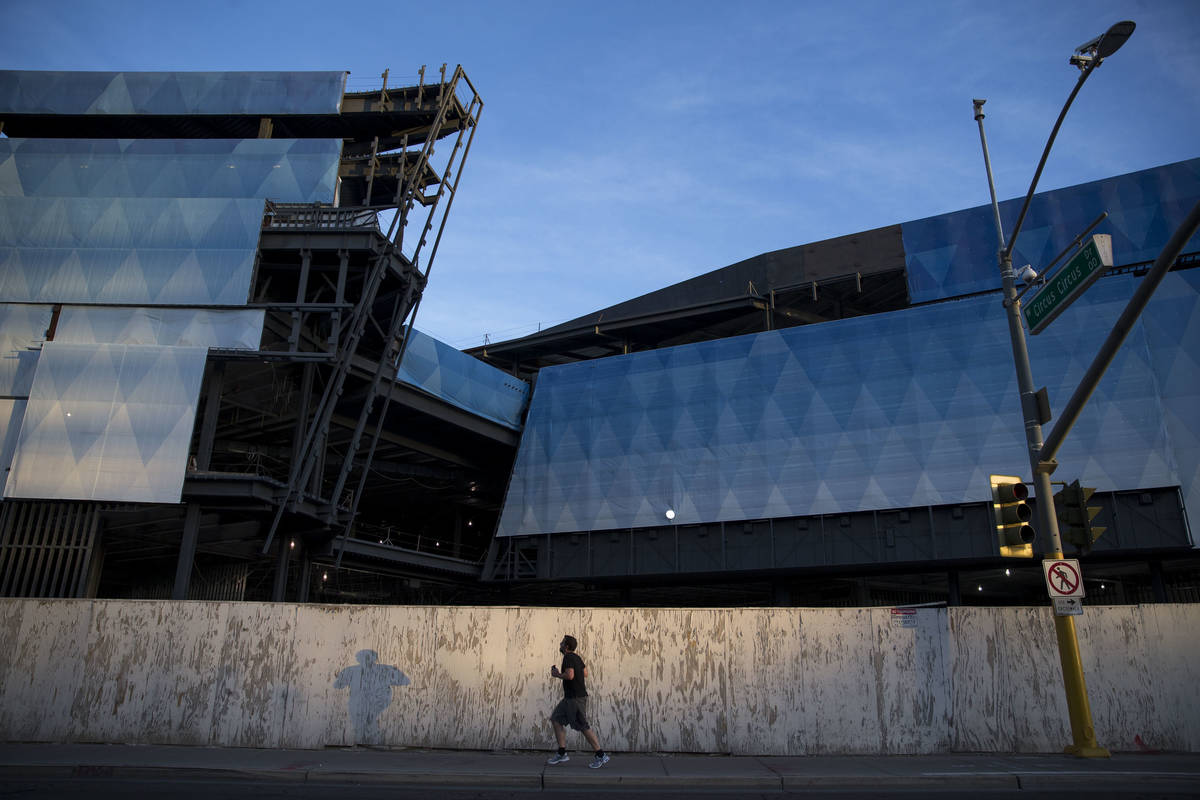 A man runs past the unfinished Fontainebleau project on the Las Vegas Strip, Wednesday, Dec. 13 ...