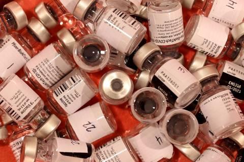 Pfizer vaccine vials at the Cashman Center COVID-19 vaccination site in Las Vegas Thursday, Feb ...