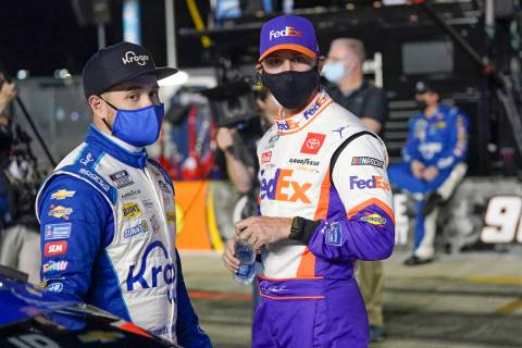 Ricky Stenhouse Jr., left, and Denny Hamlin talks on pit road before the first of two qualifyin ...