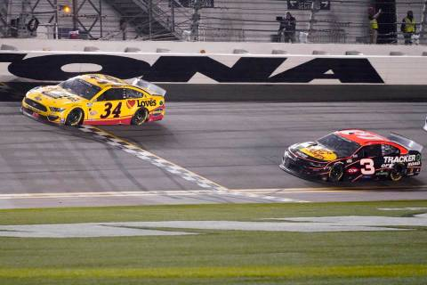 Michael McDowell crosses the finish line ahead of Austin Dillon to win the NASCAR Daytona 500 a ...