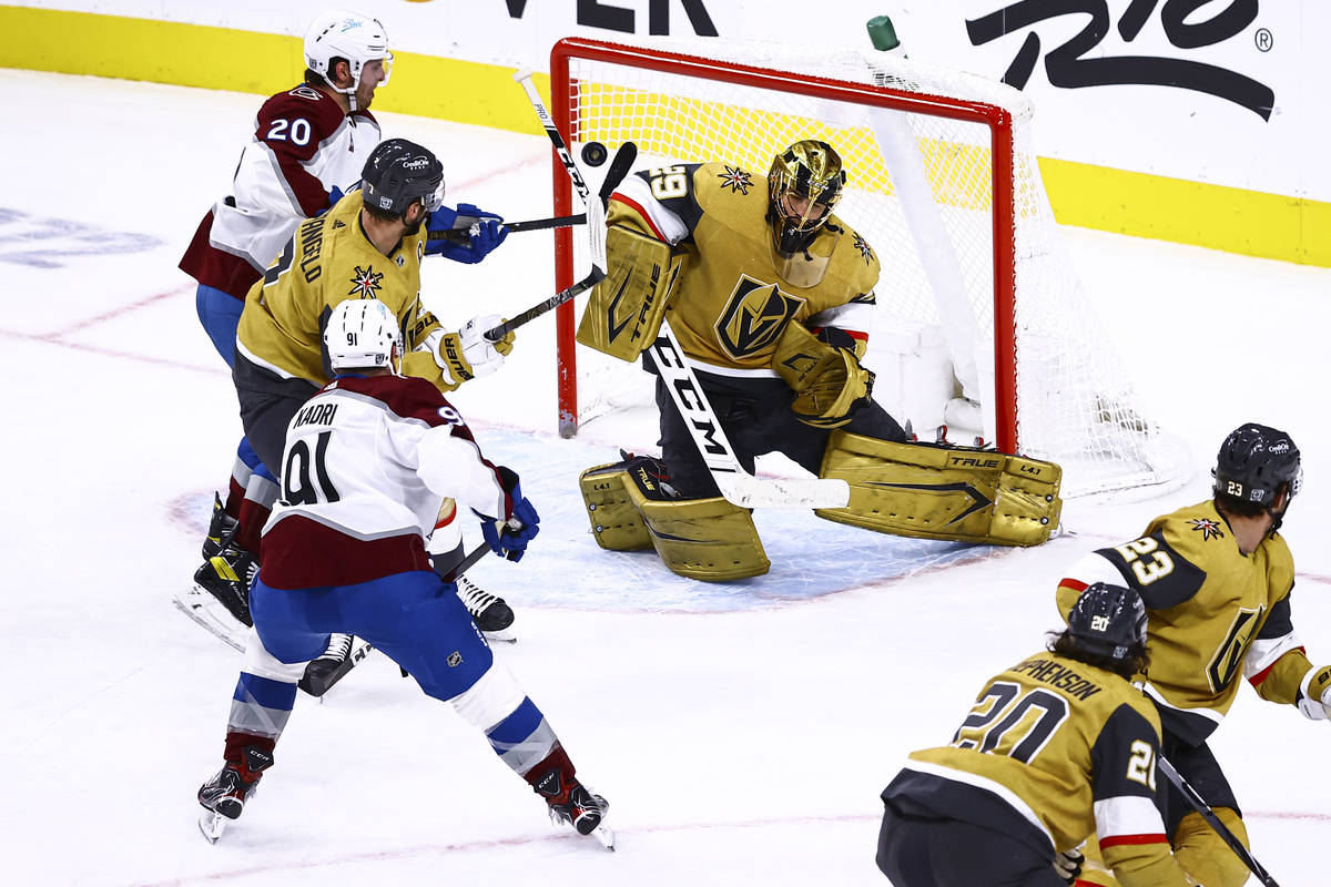 Golden Knights goaltender Marc-Andre Fleury (29) blocks the puck against Colorado Avalanche dur ...