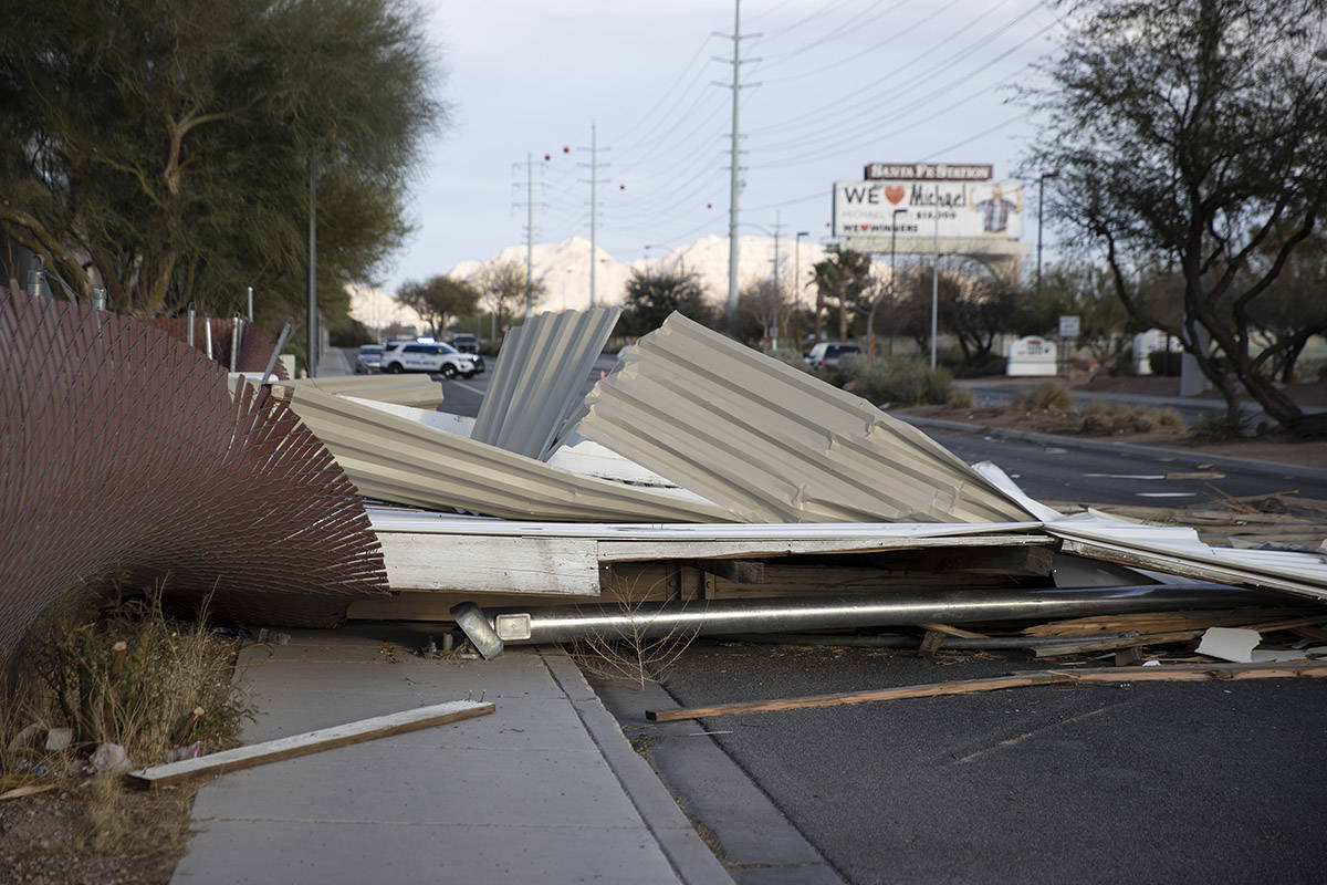 A fallen movie screen from the West Wind Las Vegas Drive-In blocks the westbound lanes of W Car ...