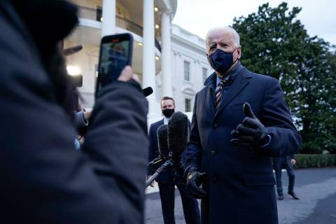 President Joe Biden speaks to reporters on the South Lawn of the White House before boarding Ma ...