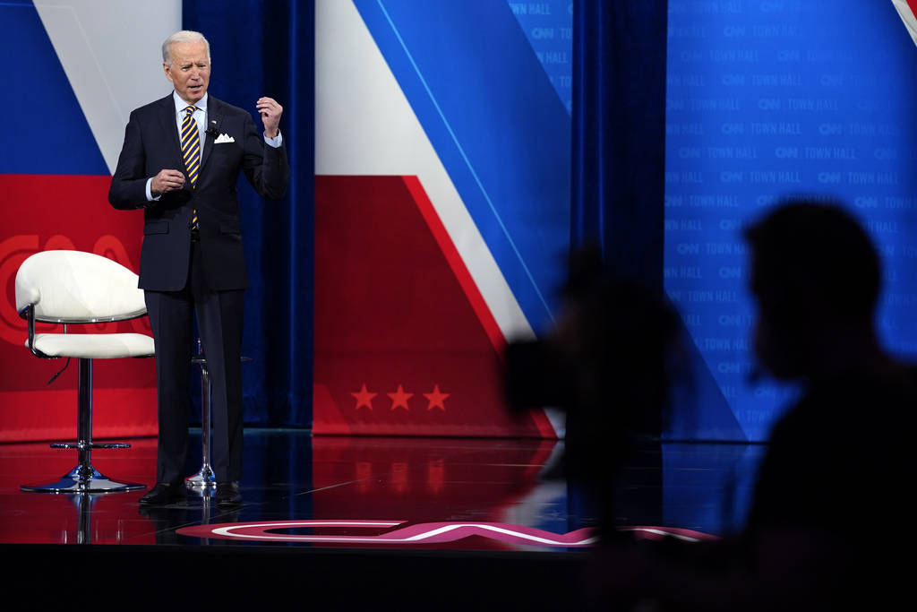 President Joe Biden talks during a televised town hall event at Pabst Theater, Tuesday, Feb. 16 ...