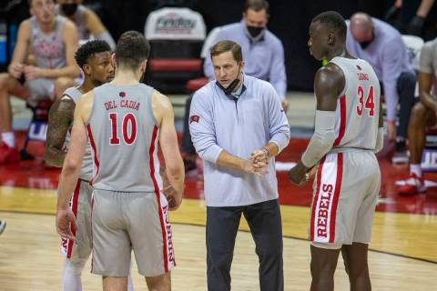 UNLV Rebels head coach T.J. Otzelberger coaches guard David Jenkins (5), forward Edoardo Del Ca ...