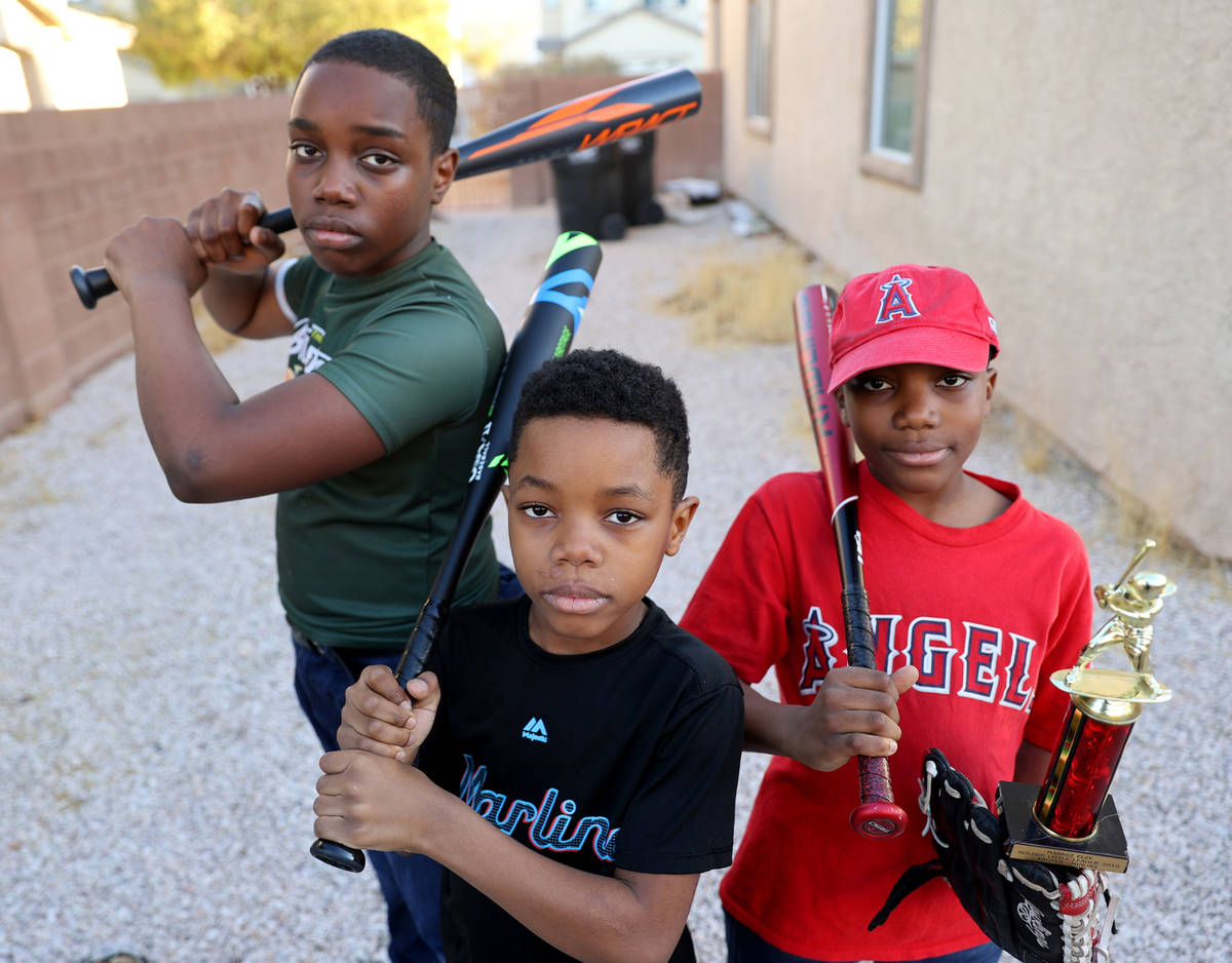 Brothers, from left, Marcel Aron Elzy, 13, Marlon Ray Elzy, 8, and Markez Lee Elzy, 9, at their ...