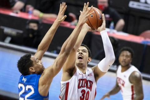 UNLV freshman forward Devin Tillis (30), shown shooting against Air Force on Saturday, Feb. 6, ...