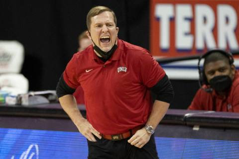 UNLV Rebels head coach T.J. Otzelberger calls an offensive play in the first quarter during an ...