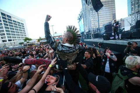 An attendee crowd surfs during the Punk Rock Bowling music festival in downtown Las Vegas on Sa ...