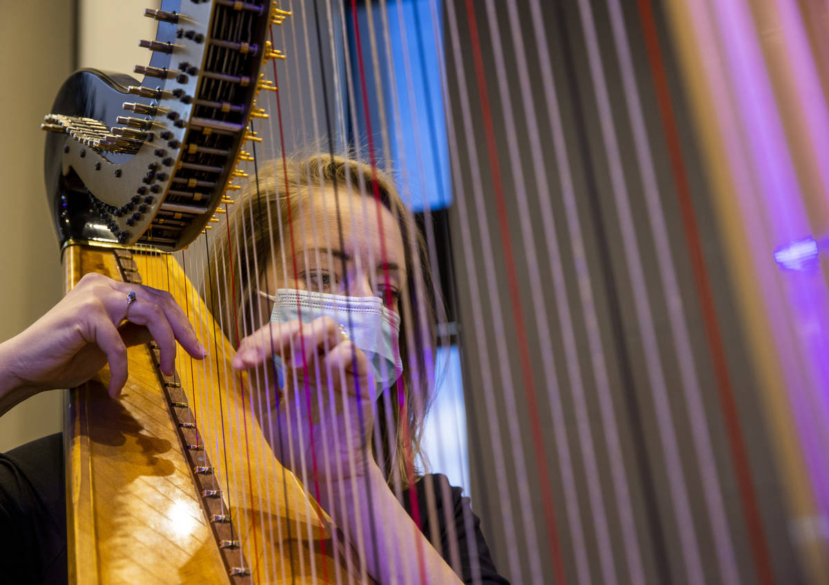 Harpist Melaney Jones plays for an Ash Wednesday service at Faith Community Lutheran Church on ...