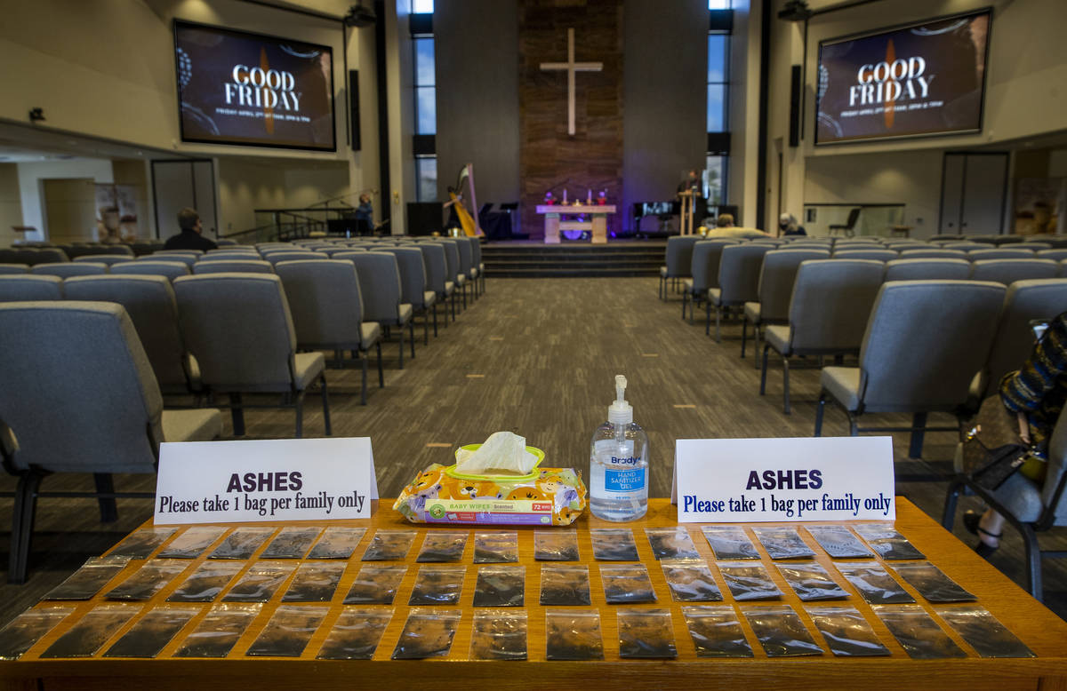 Ashes are placed in individualized bags for worshipers to apply during an Ash Wednesday service ...