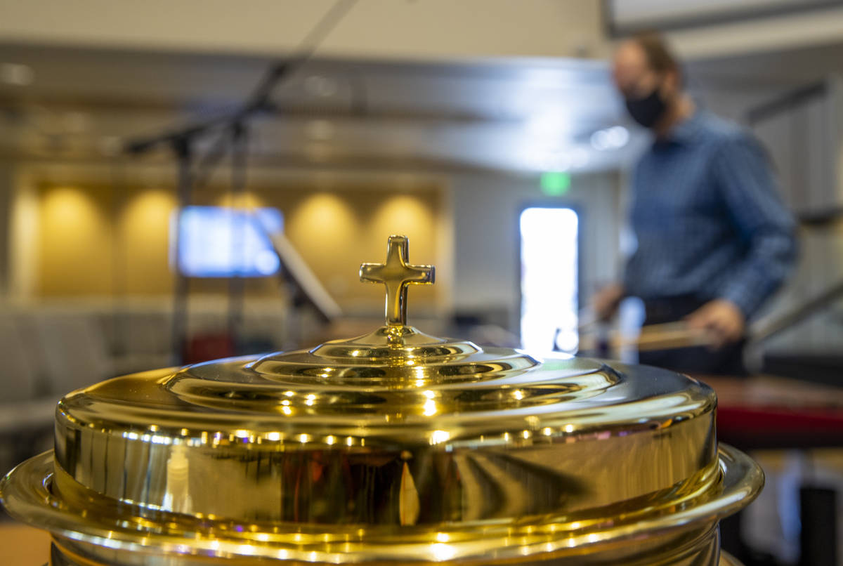 A communion vessel is in place as Tim Jones plays the marimba for an Ash Wednesday service at F ...