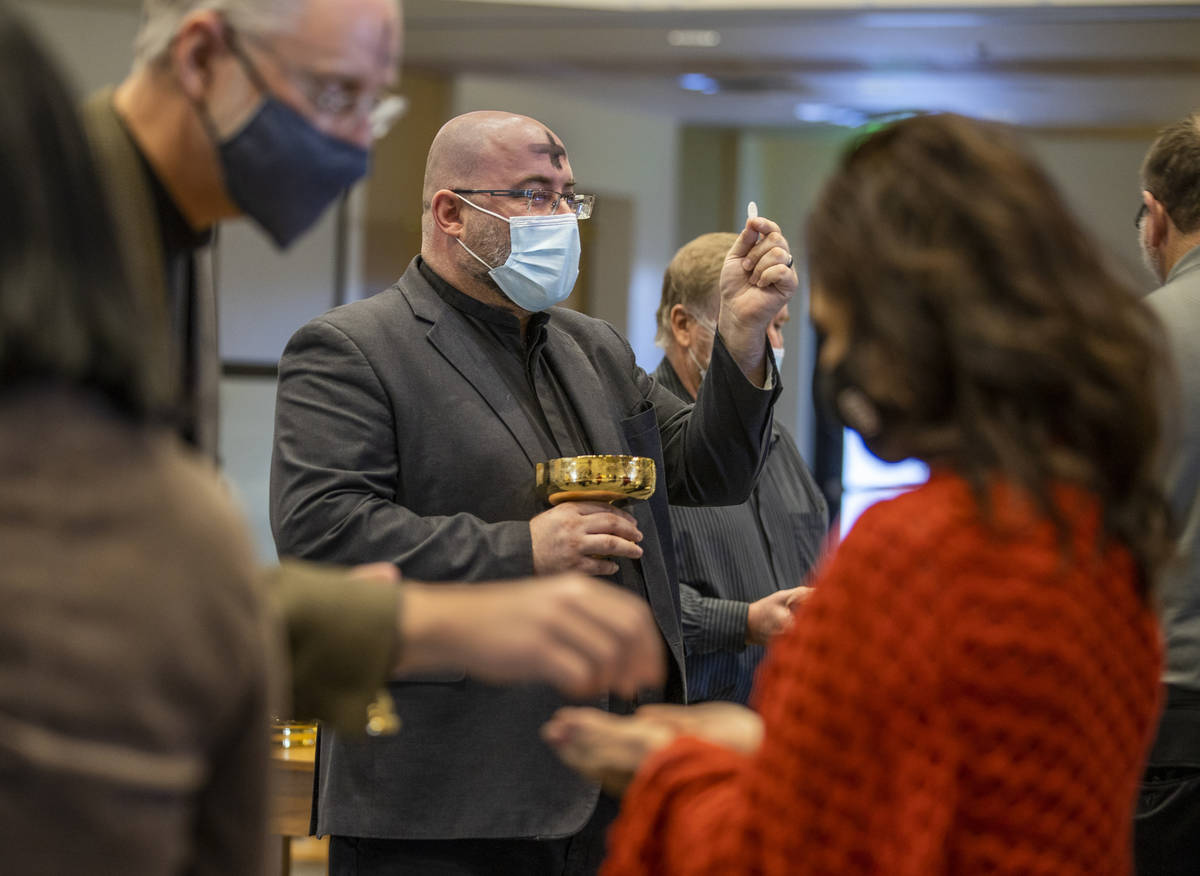Pastor Bob Sundquist, center, and Pastor Craig Michaelson lead communion during an Ash Wednesda ...