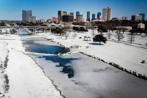 The Trinity River is mostly frozen after a snow storm Monday, Feb. 15, 2021, in Fort Worth, Tex ...