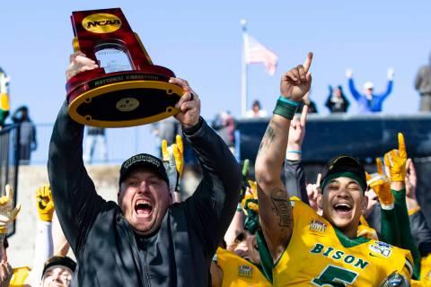 In this Jan. 11, 2020, file photo, North Dakota State head coach Matt Entz raises the trophy al ...