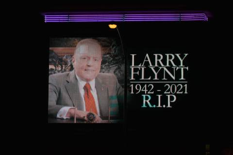 The screen located in the vicinity of the Hustler nightclub pays tribute to Larry Flynt, who re ...