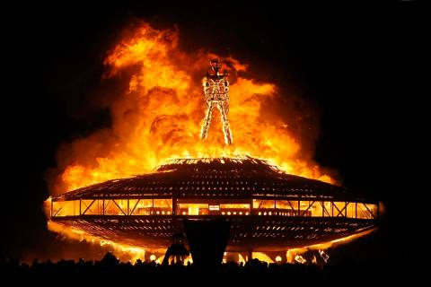 """In this Aug. 31, 2013, file photo, the """"Man"""" burns on the Black Rock Desert at Burning Man near ..."""