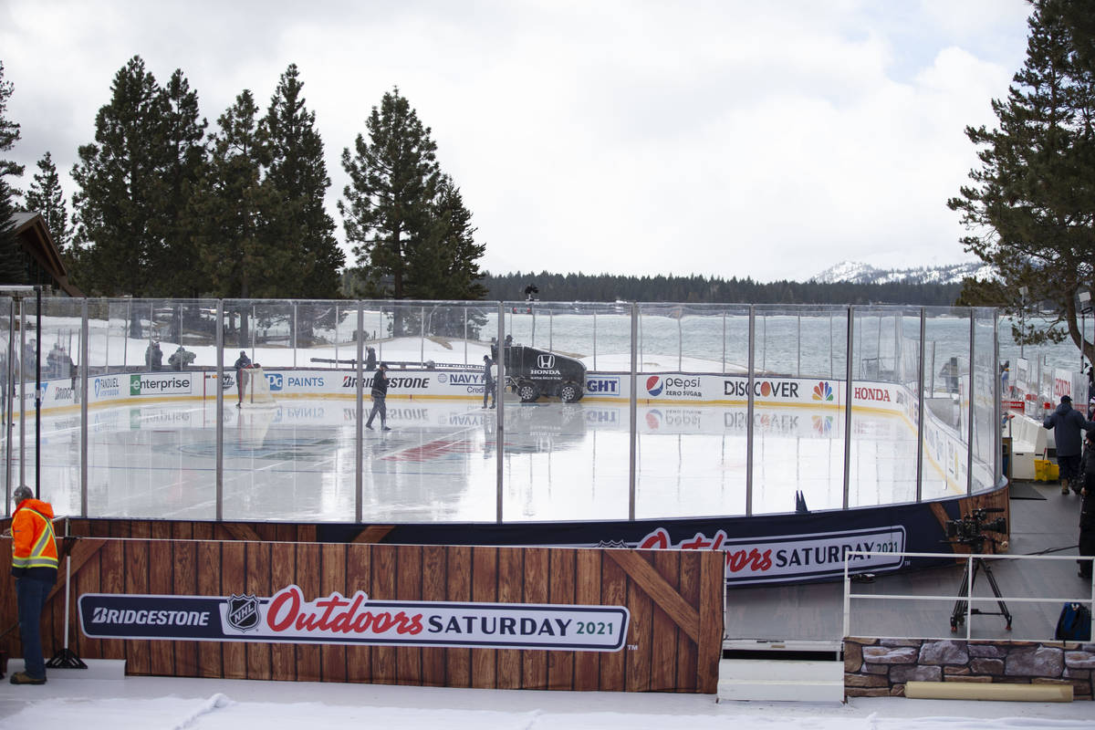 A zamboni cleans the ice prior to a practice on an outdoor rink in preparation for a Saturday N ...