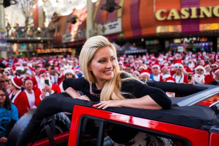 Holly Madison serves as grand marshal of the Las Vegas Great Santa Run in downtown Las Vegas on ...