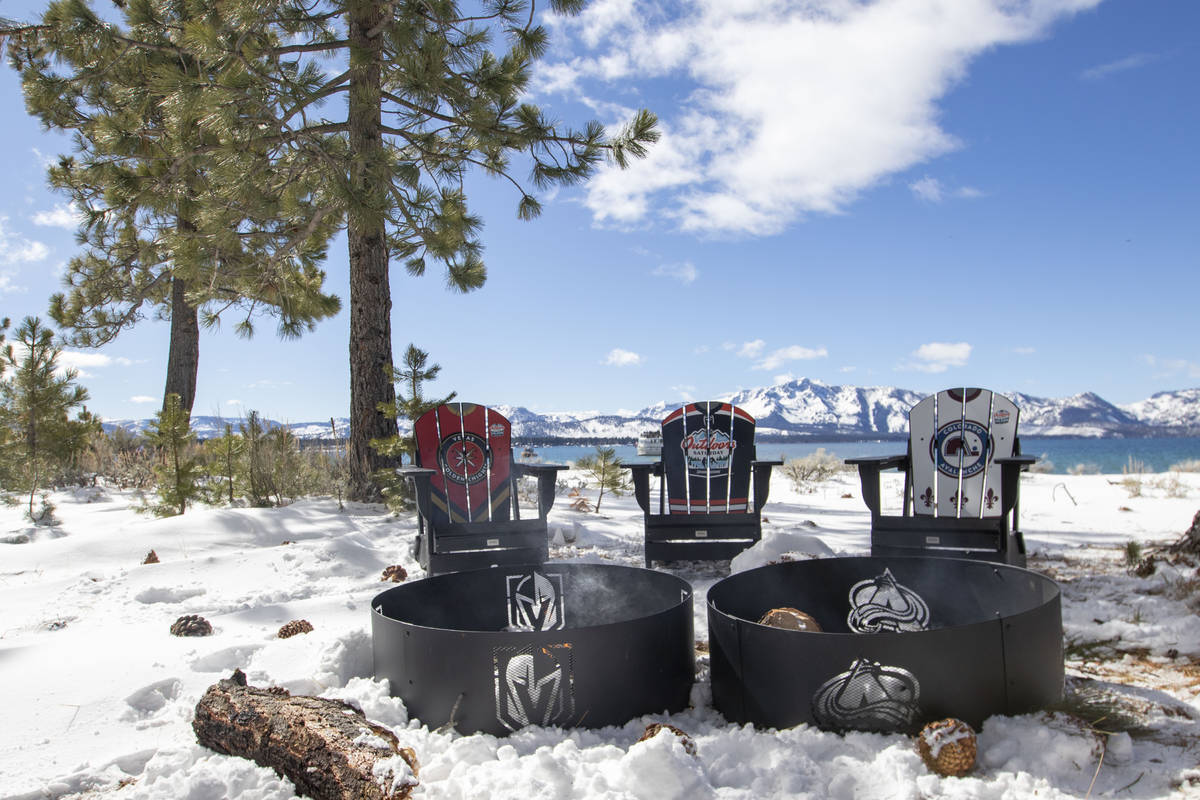 Chairs showing the teams logos are placed near fire pits on Lake Tahoe during the first period ...