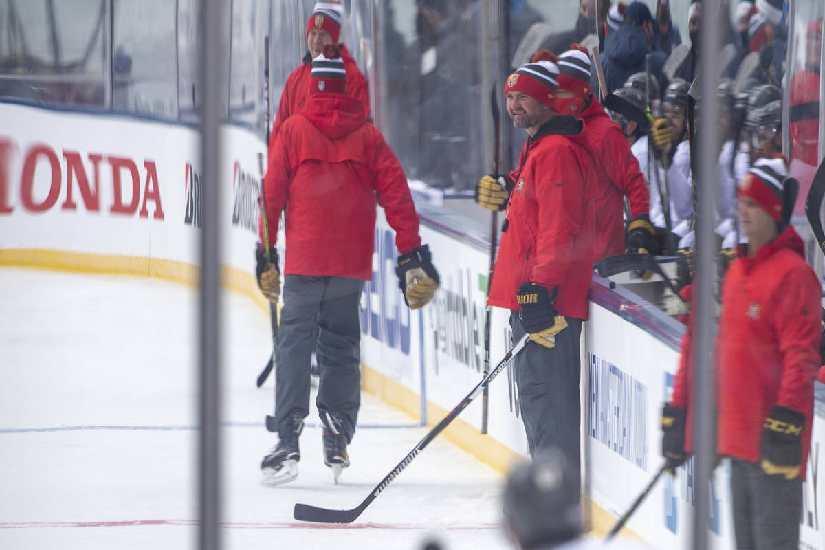 Vegas Golden Knights head coach Pete DeBoer, center, looks on as the team practices on an outdo ...