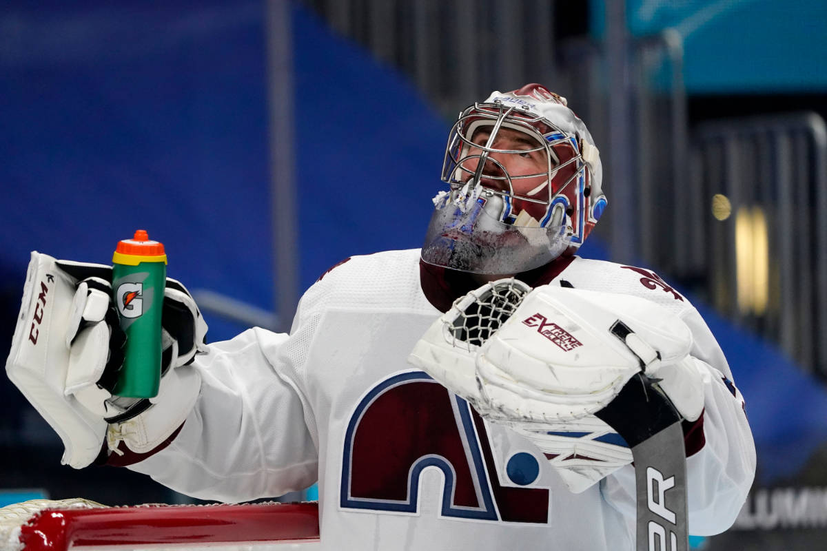 Colorado Avalanche goaltender Philipp Grubauer grabs his water bottle after giving up a goal to ...