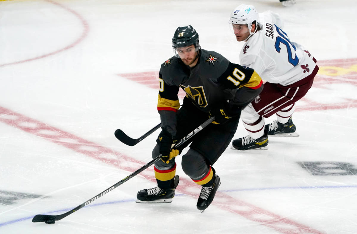 Vegas Golden Knights center Nicolas Roy, front, drives past Colorado Avalanche left wing Brando ...