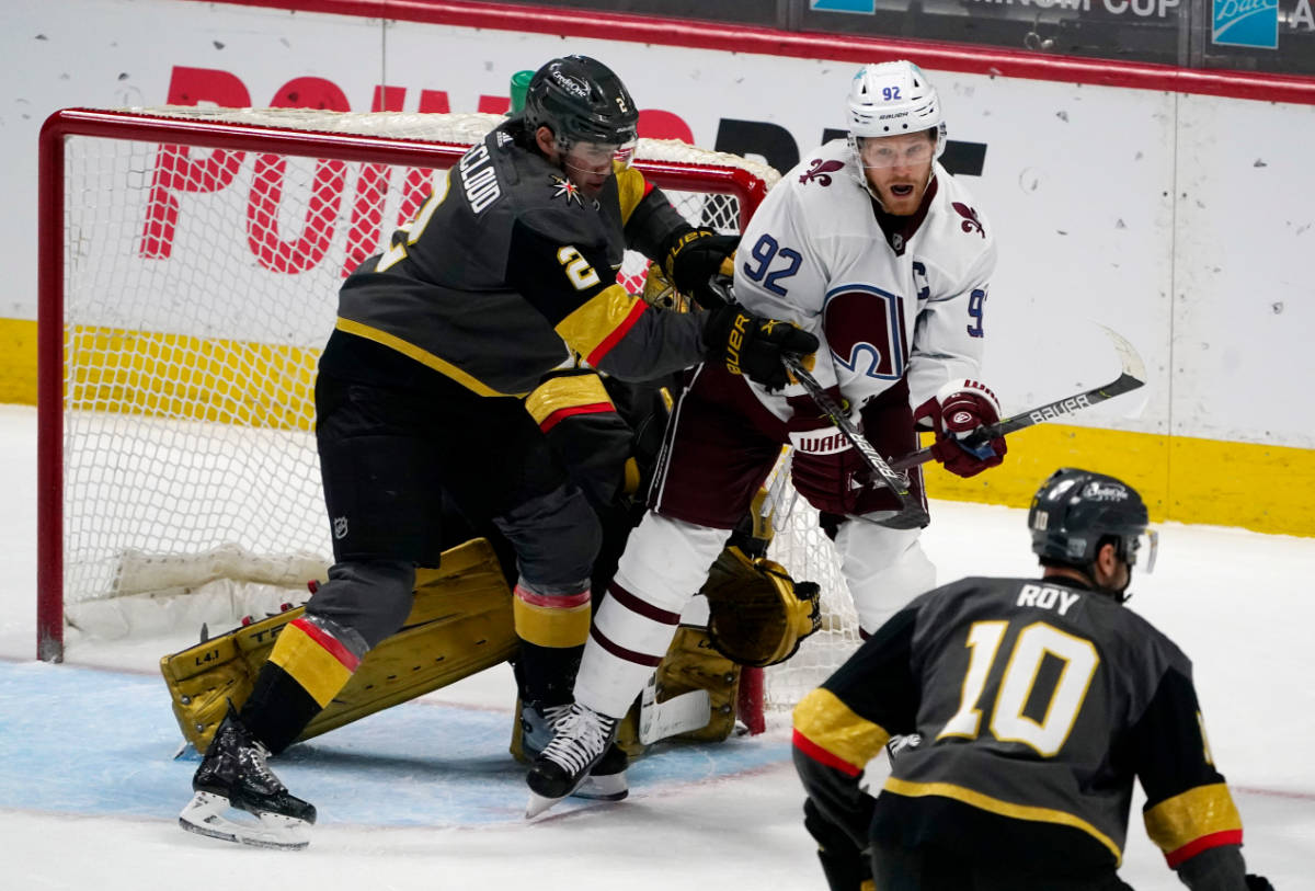 Colorado Avalanche left wing Gabriel Landeskog, back, right, fights for position in front of th ...