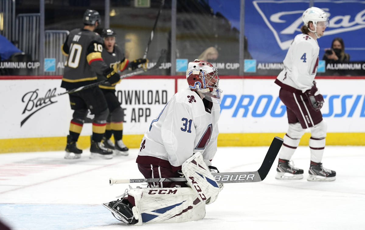 Colorado Avalanche goaltender Philipp Grubauer, front, reacts after giving up a goal to Vegas G ...