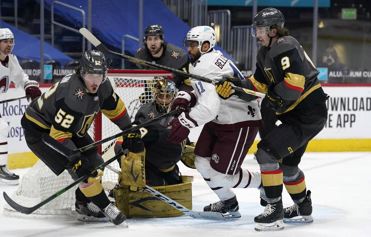 Colorado Avalanche center Pierre-Edouard Bellemare, third from left, battles for control of a l ...