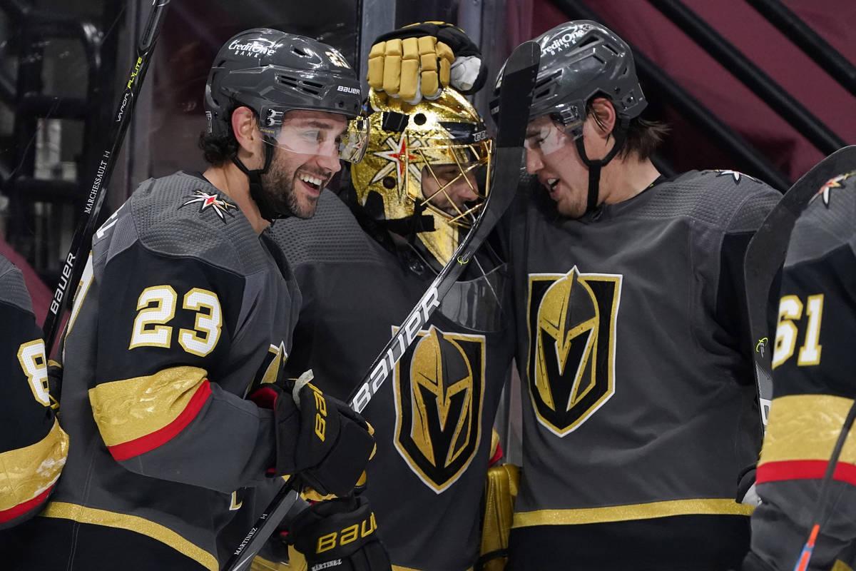 From left to right, Vegas Golden Knights defenseman Alec Martinez, goaltender Marc-Andre Fleury ...