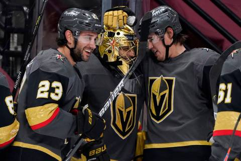 From left to right, Vegas Golden Knights defenseman Alec Martinez, goaltender Marc-Andre Fleury ...