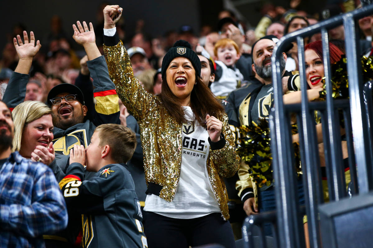 Golden Knights fans celebrate a goal by Tomas Nosek, not pictured, during the first period of a ...