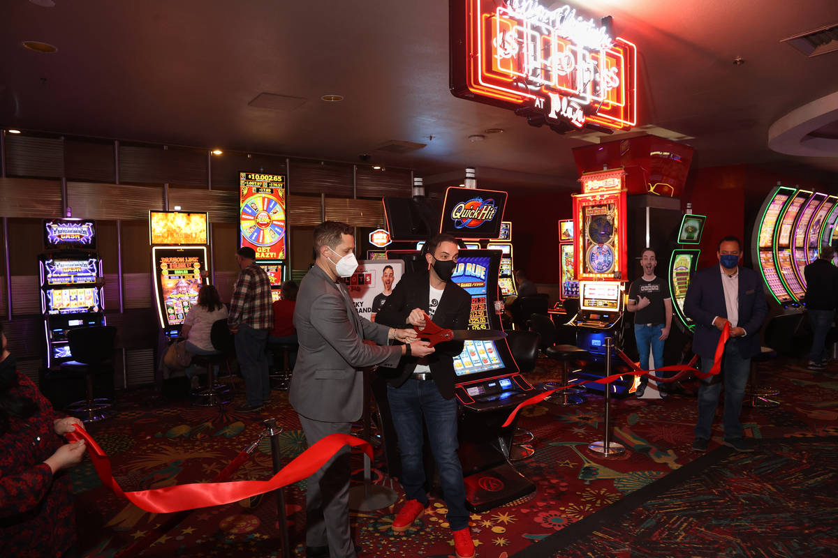 Slot machine YouTuber Brian Christopher, right and Plaza CEO Jonathan Jossel cut the ribbon on ...